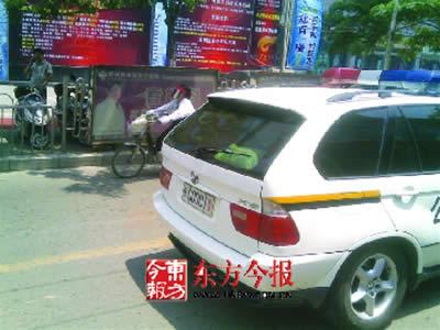 """中国一号首长的车牌是-车牌号为""""豫Q0001警""""的宝马车-河南驻马店警方配宝马警车为领导图片"""