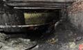 本溪一黑煤窑火灾13名矿工被困