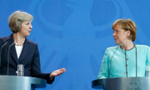 英新首相访德会默克尔 称今年不会开启脱欧谈判