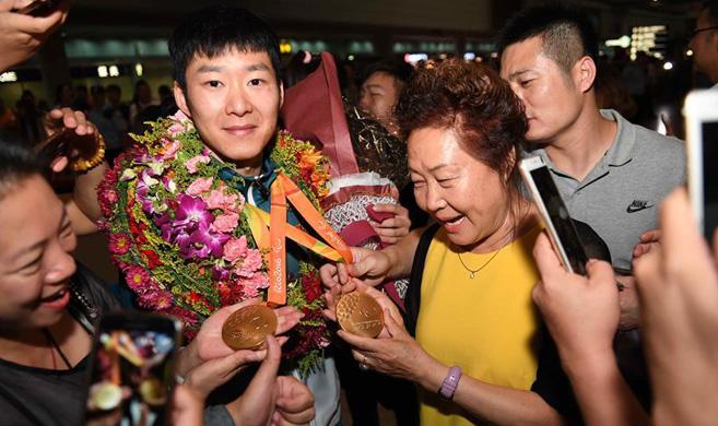 里约残奥会中国代表团抵京
