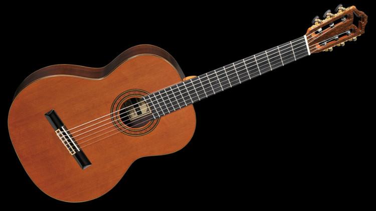 文化·体育    吉他根据不同的结构和发声原理可以大致分为木吉他