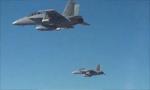 美军用战机释放逾百架微型无人机 测试集群飞行