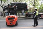 北京:机动车乱停乱放或将面临双处罚