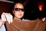 中国游客被美警察当毒贩殴打 13年后获赔46万美元