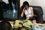 """泰国女子运毒被查 施""""美人计""""迷惑警察"""
