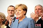 德国重启政府组阁试探性谈判 默克尔表达乐观态度