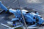 自卫队直升机坠入民宅伤人 安倍为坠机事件道歉