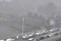 """镜头下进入""""暴雨模式""""的北京"""