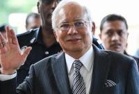 马来西亚前总理纳吉布被加控25罪名 获准保外候审