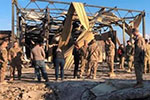 伊拉克北部美军基地遭火箭弹袭击 美出动军用飞机低空飞行