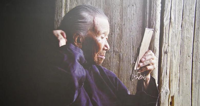 """只为一个""""等""""字 她守候了七十多年"""